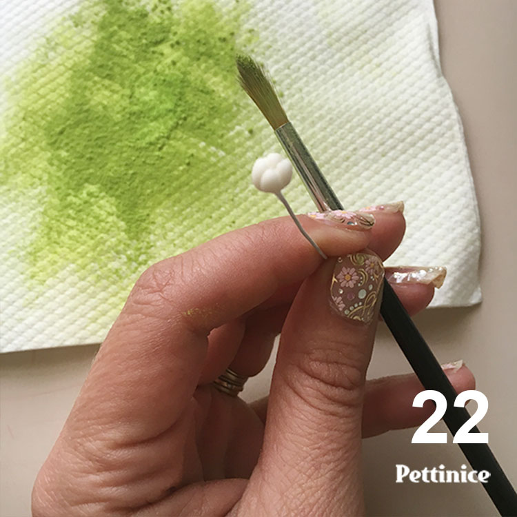 Get some spring green or lime green petal dust on a paper towel.
