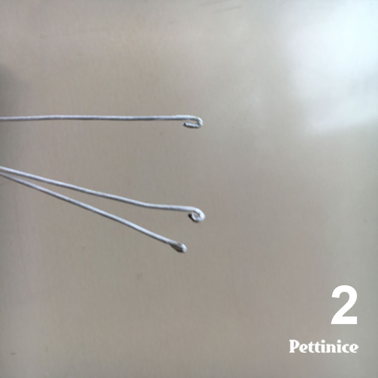 Then using the wire cutter gently bend over the tips to make wee tiny hooks.