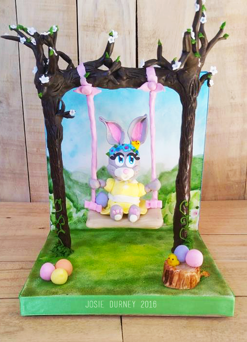 Easter Bunny on a swing by Josie Durney