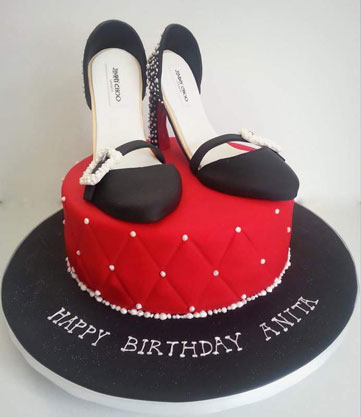 Pair of black heels on red cake by Angela Miller‎