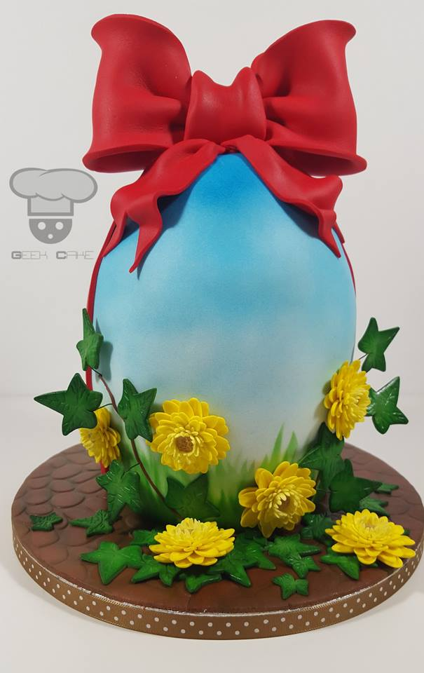 Large Blue Easter Egg with Red Bow and yellow gerberas by Geek  Cake