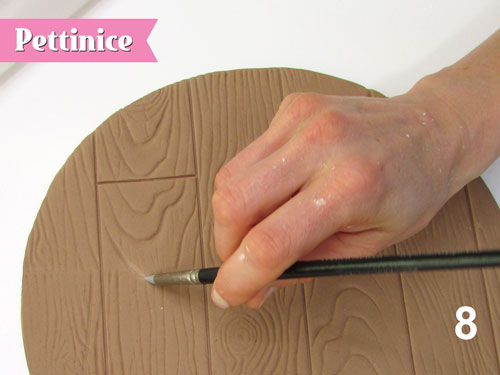 Step 8: Use clay smoothing tools to go over any of the wood grain.