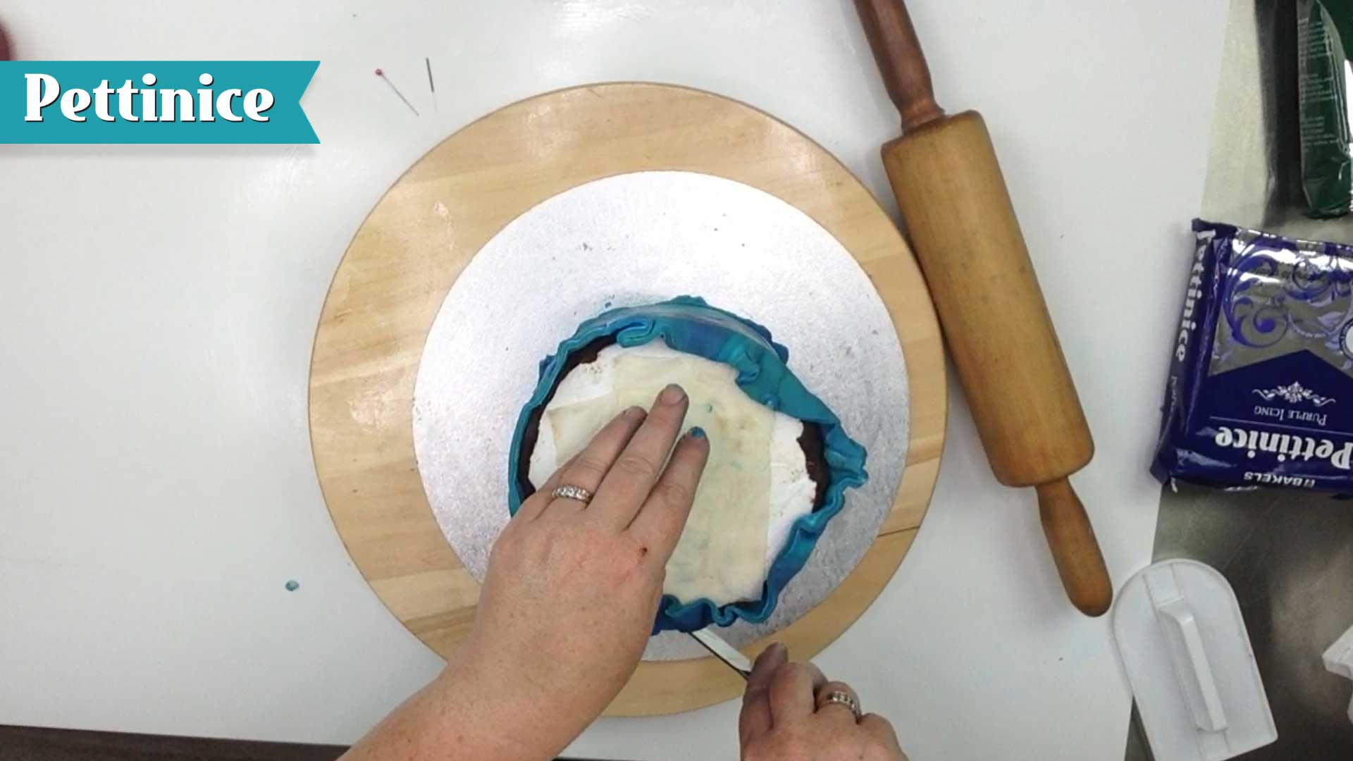 Keeping knife straight, trim off excess fondant.