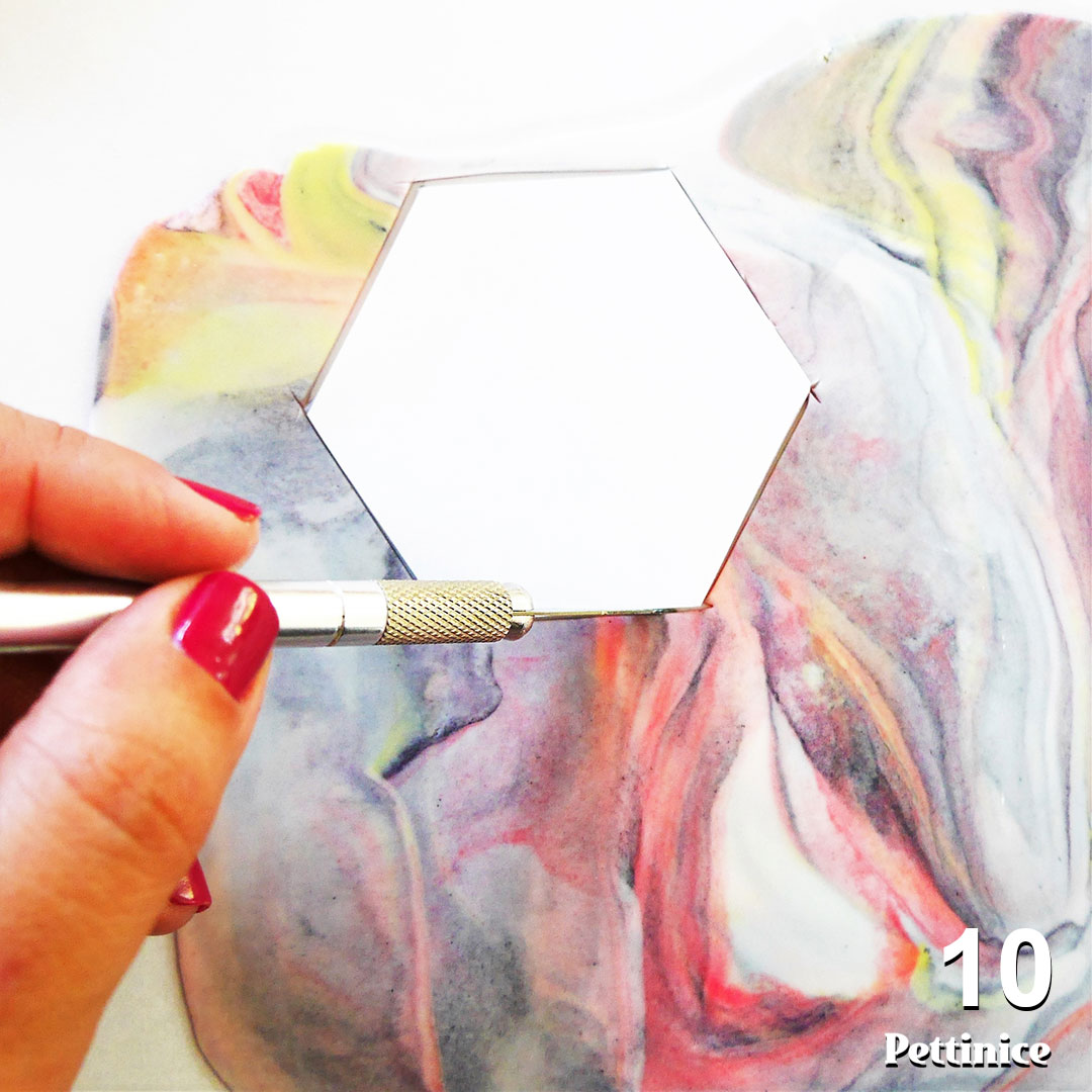 Step 10: Use your template and craft knife, or desired cutter to create your accent pieces.  Please note:  You cannot roll up the scraps and have a nice marble pattern the second time around, so get as many cuts as possible from this piece of gumpaste.
