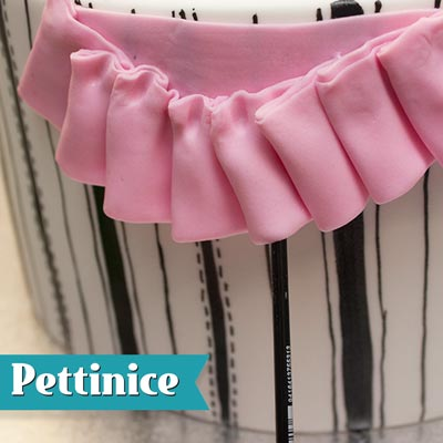 Lift each pleat out using the top of your brush to create movement in the ribbon.