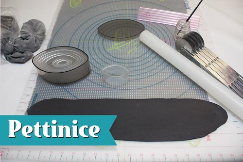 Mix 150g Black Pettinice fondant with 1/2tsp of tylose and roll out thinly.