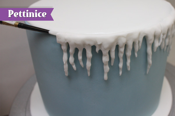 Attach the molded icicles to the top edge of the cake so it joins the white circle.
