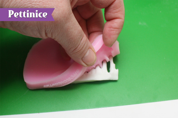 Fill Icicle mould with fondant and place in the freezer for 5 mins to firm up.  Remove from mold as shown.