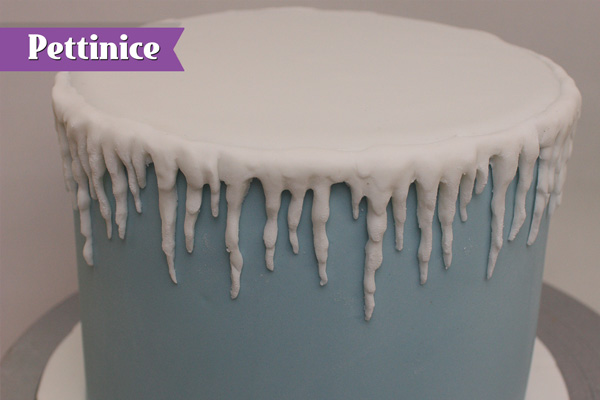 Keep attaching icicles around entire cake.