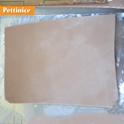 Roll out a thick rectangle of fondant which will be your bottom book cover, and put it on some baking paper .