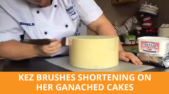Brush your shortening all over your ganached cake.