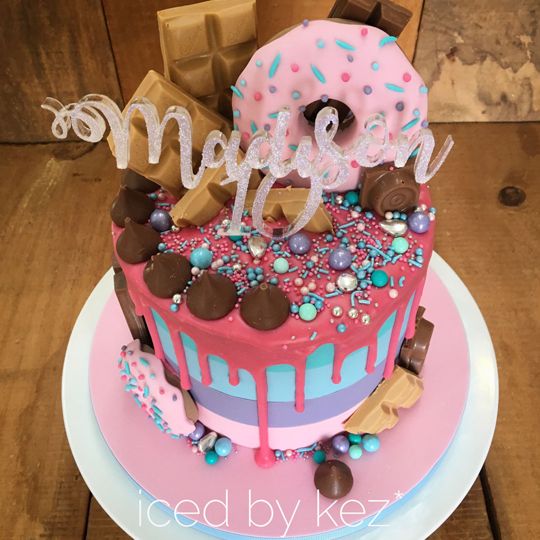 Final step is to add your chocolate drip and decorate with sprinkles, cut chocolate bars and more.  See how I made the donuts in my tutorial.