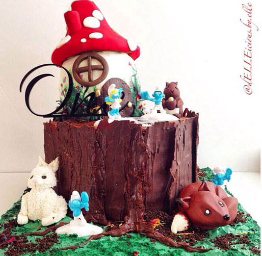 Smurfs and woodland creates cake by Ella West