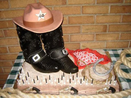 Cowboy boots and hat cake by Myrtle van den Berg