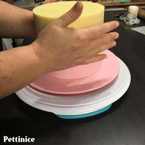 Move cake onto your prepared cake board & repeat the previous steps for the next two colours.