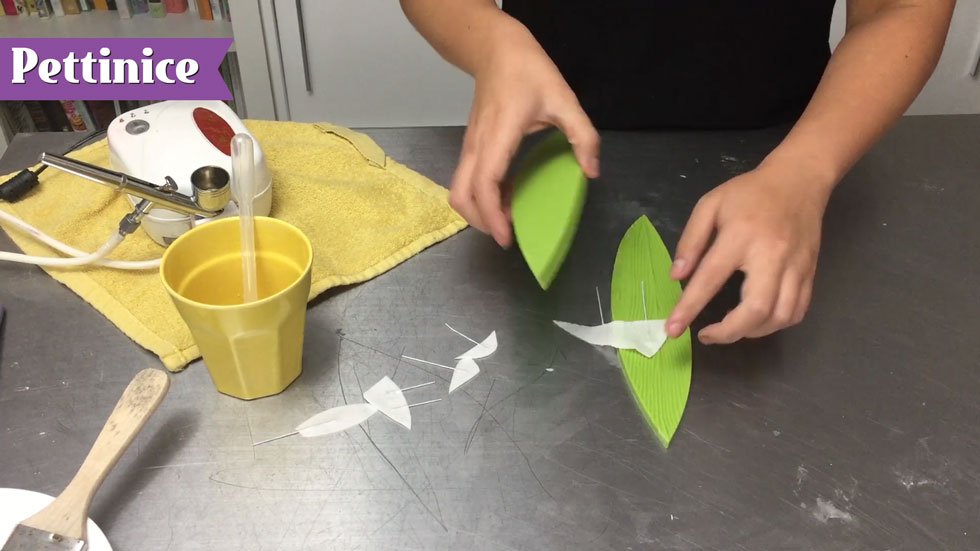 Create texture by pressing damp wafer fins between leaf embosser.