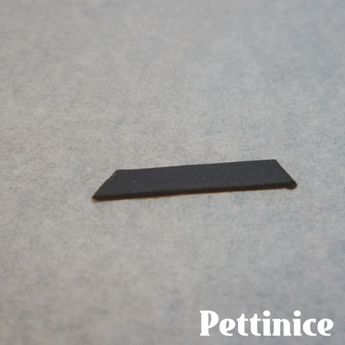 For optional lashes, cut a strip of black fondant.