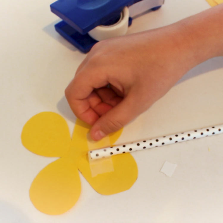 Use a piece of tape to attach to a straw or skewer.
