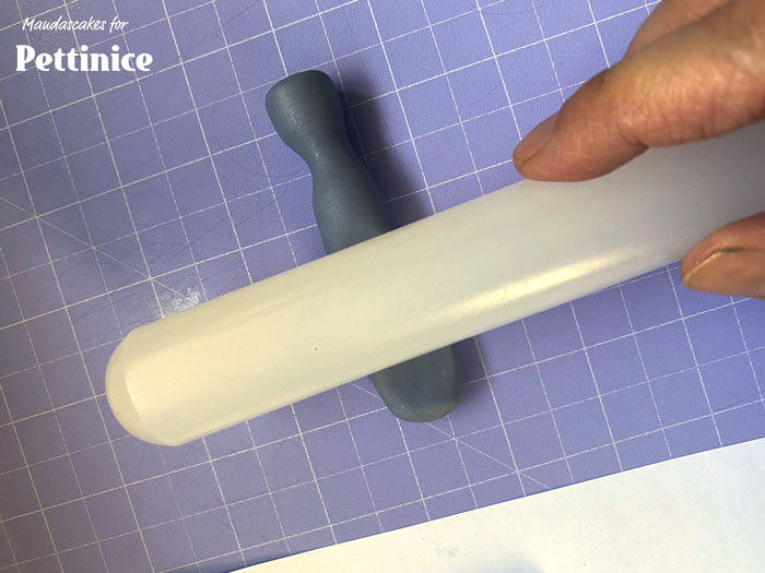 Flatten the part the hits the nails by rubbing it on a flat surface.  Flatten the other end with a rolling pin.